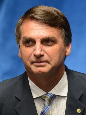 Head and shoulders photo of a man in a suit