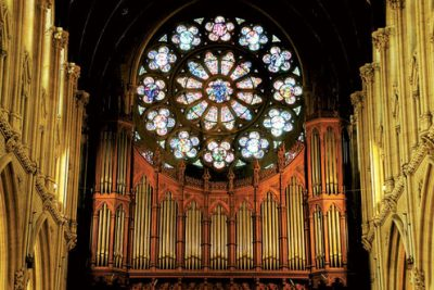 Photo of inside of a cathedral, showing rose window.