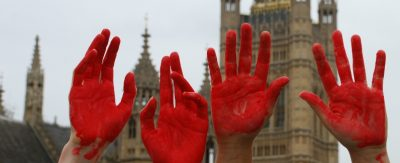 Close-up of red painted hands
